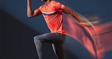 A man jumping in a red shirt